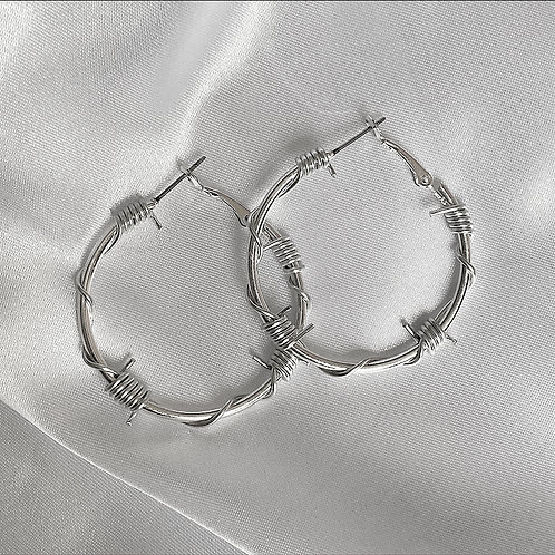 Medium silver barbed wire hoop earrings