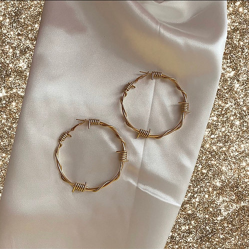 Large gold tone barbed wire hoop earrings