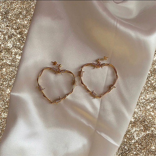 Gold barbed wire heart stud earrings