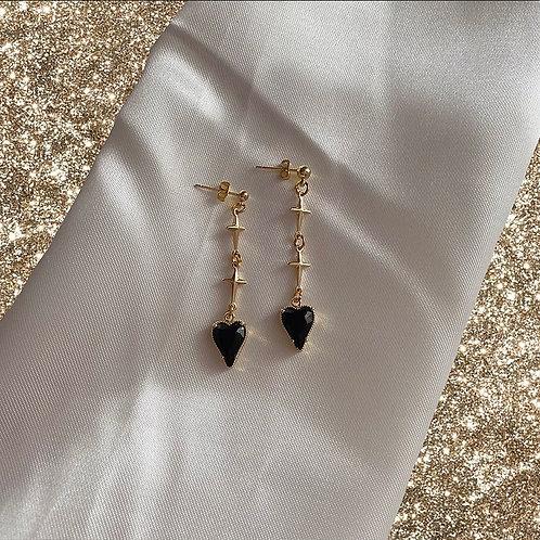 Black heart and gold cross earrings