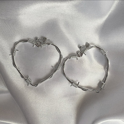 Silver barbed wire heart stud earrings