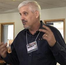 JOHN TALKING EXPRESSIVELY AT BREAK (002)