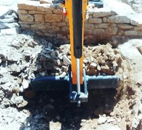 a wall and a backhoe in Ucetia