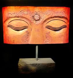 Thai Buddha mask on wooden base