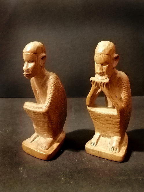 Vintage African crouched figures