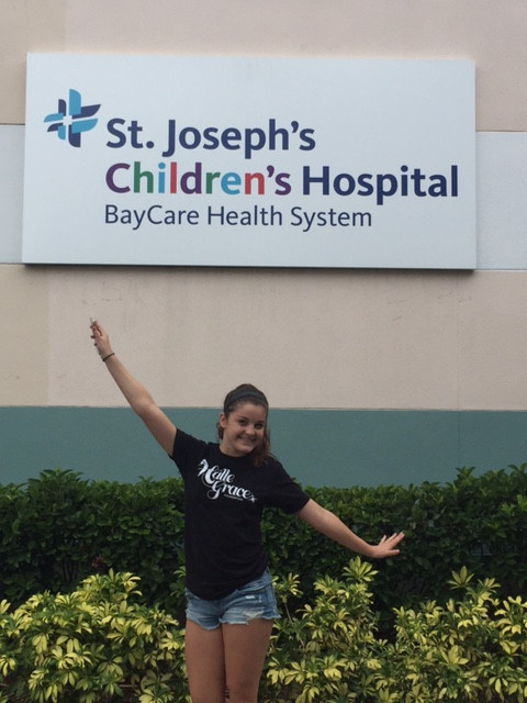 Neeley posing in front of St. Joe's