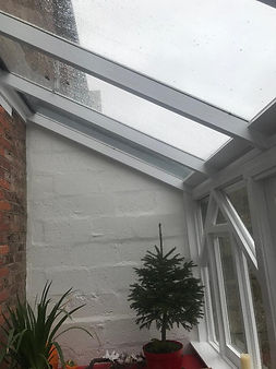 Conservatory repaired and painted