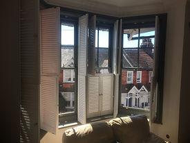 shutters added to sash window bay St Leonards on sea