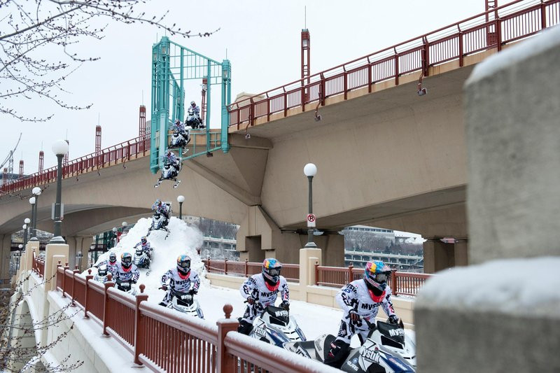 Levi LaVallee drops off the Wabasha Bridge during Red Bull Frozen City in Saint Paul, MN on January 20, 2016