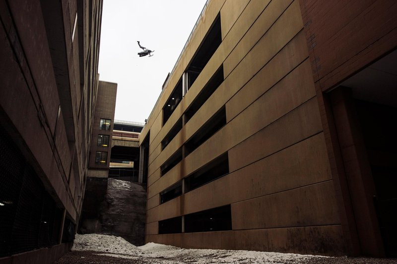 Levi LaVallee performs a Superman over a roof gap during Red Bull Frozen City in Saint Paul, MN on January 25, 2016