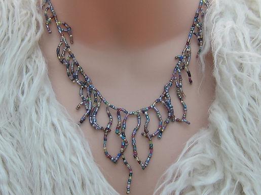 Graduated fringed bead necklace