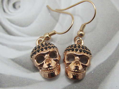 Rose gold plated silver and cubic zirconia skull earrings