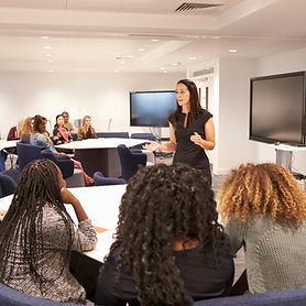 female-teacher-addressing-university-students-in-a-PUNGHRW.jpg