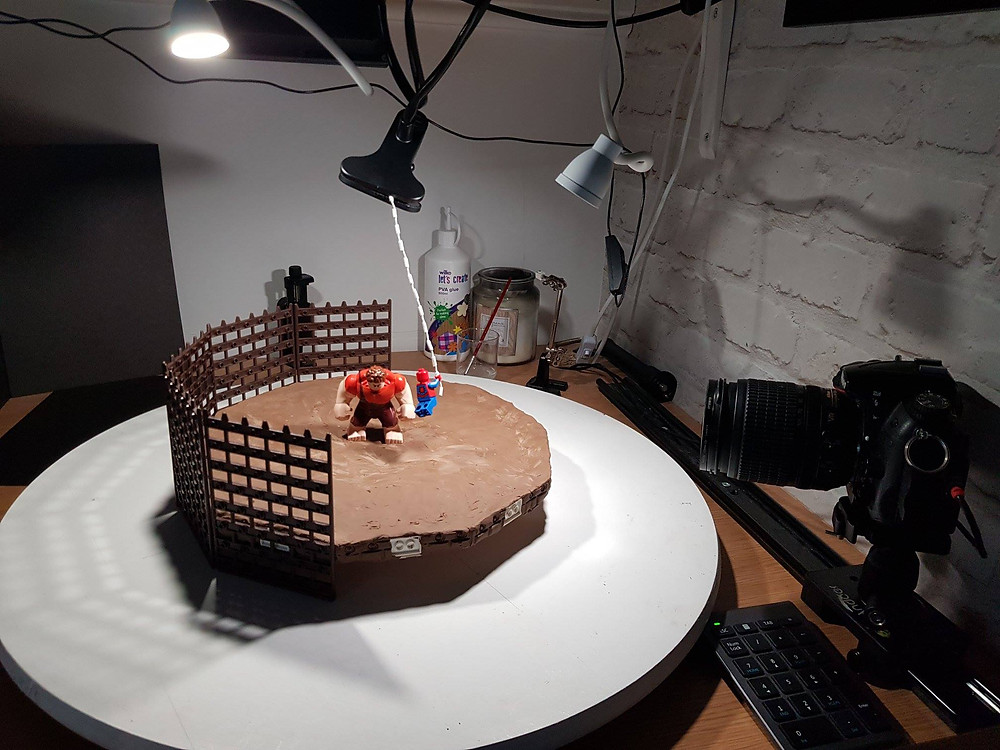 Look behind the scenes as Wreck It Ralph and Spiderman fight it out in an arena stop motion battle