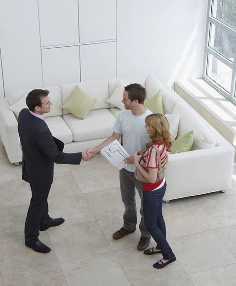 Realtor discussing plans with homeowners