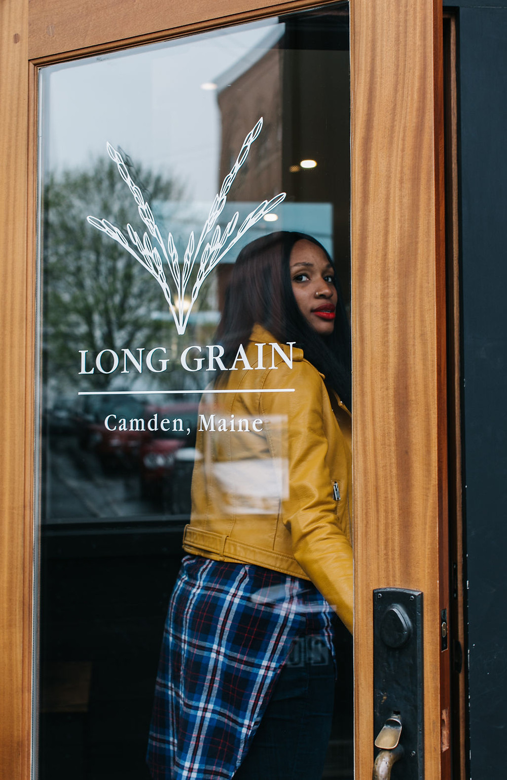 Woman at Long Grain restaurant gazing out door.