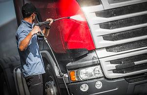Truck Driver Washing His Semi Truck Trac