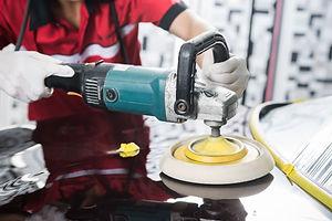Car detailing series _ Worker polishing