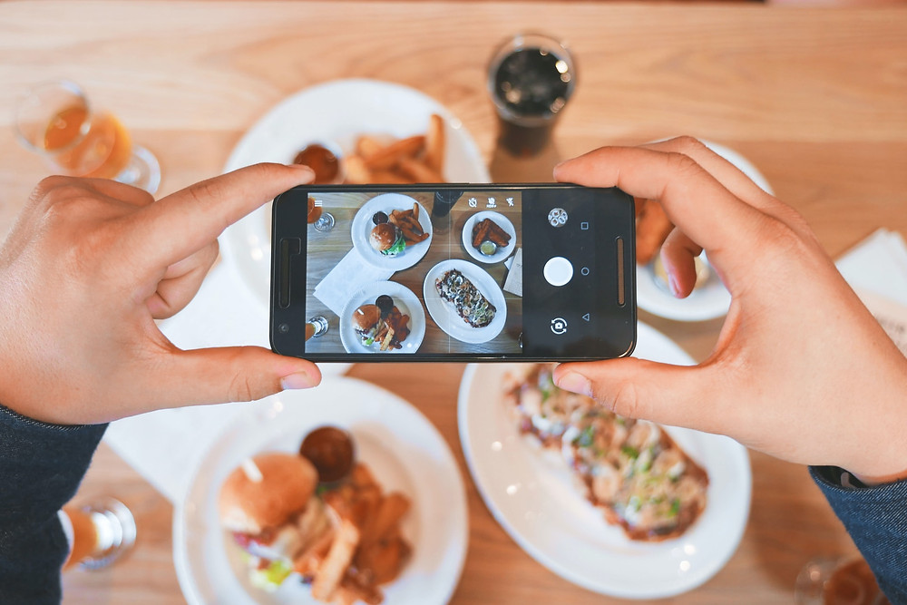 taking a picture of a meal