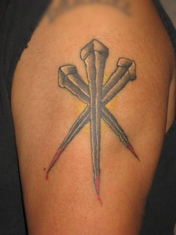 American Traditional Tattoo of three spikes a religious example of American Traditional Tattoo Style