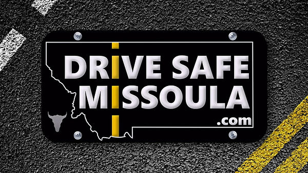 Drive Safe Missoula Logo on an image of a roadway with a yellow and white road stripe.