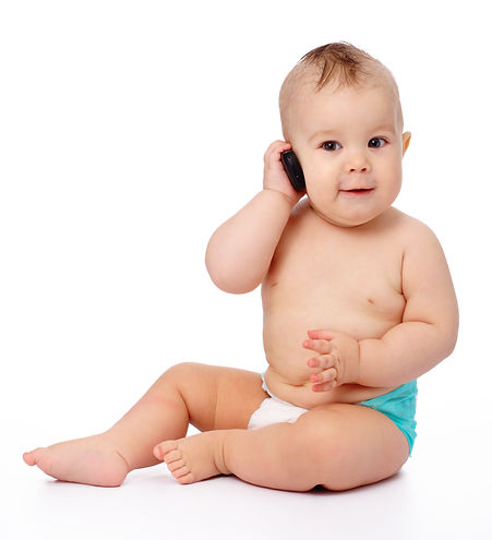Cute little baby is talking on cell phon