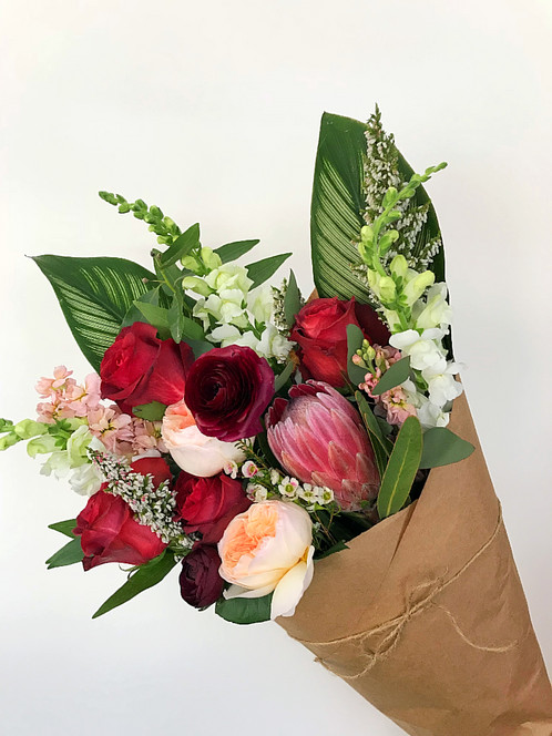 Hand tied flower bouquet wrapped in paper by MI French Paper Company