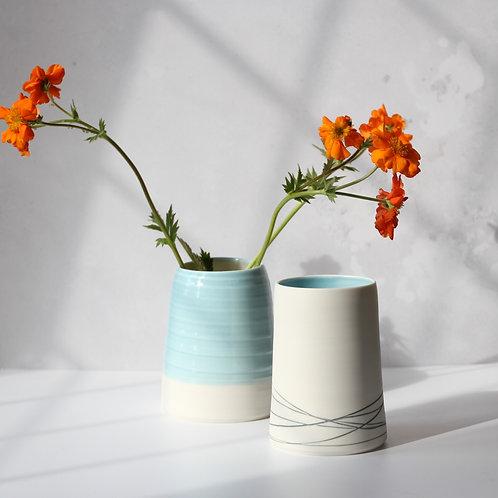 Porcelain vase with grey slip inlay detail
