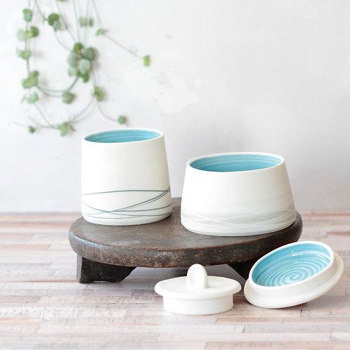 Lidded Porcelain pots, turquoise interior