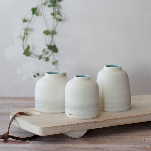 Porcelain bud vase with turquoise interior