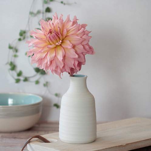 Porcelain vase with turquoise interior