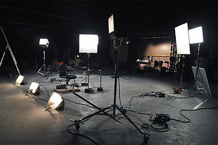 video production scene with spotlights and cameras