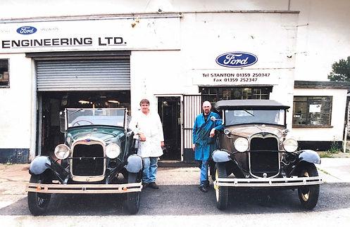 old photo of vintage cars outside Belcher Engineering