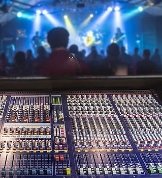 front-of-house-soundboard-at-rock-gig-pi