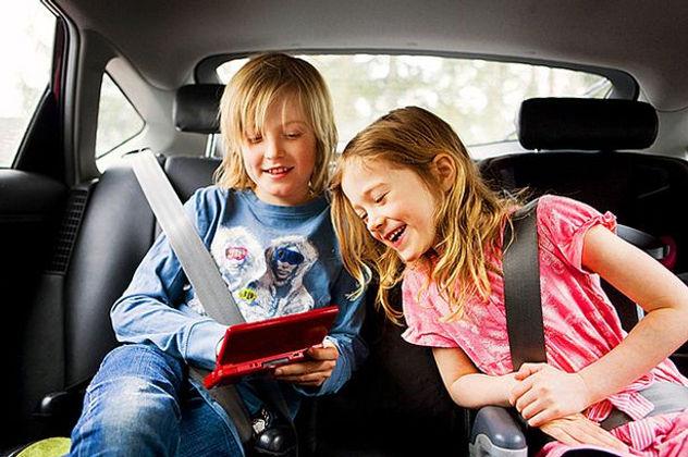 Kids in back seat of car
