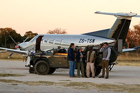 Pilatus PC12 with game vehicle.jpg