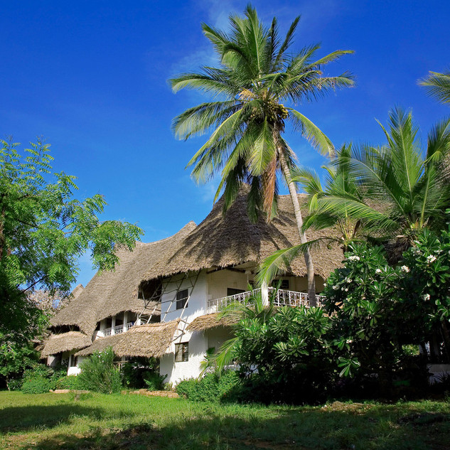 Thatched Chalets and lush gardens