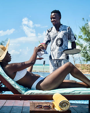 Pool Lady on lounger with waiter serving