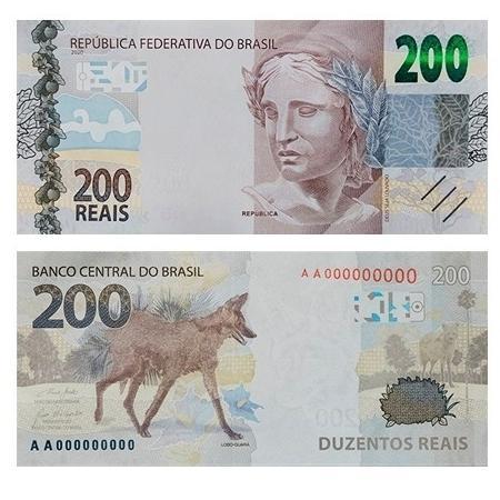 A imagem mostra a nova nota de 200 reais. Ela é azul acinzentada, traz a figura do lobo-guará à esquerda.