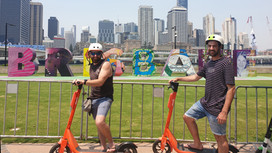 SAFEgroup Automation team riding scooters in Brisbane