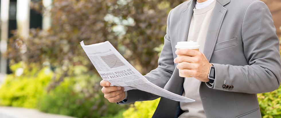 SAFEgroup Automation - image of a man reading a newspaper and holding a coffee
