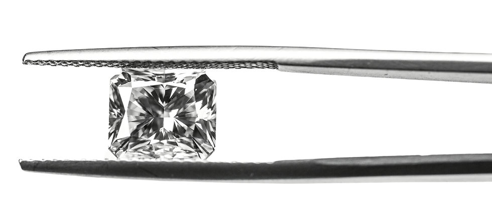 synthetic moissanite diamond simulant picture in gem tongs. Header for The Gem Academy online education school