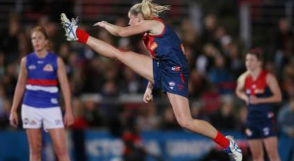 That's how to kick a footy: Melbourne's Tayla Harris takes a set shot in Saturday's exhibition match.  Image credit: Michael Klein, Herald Sun