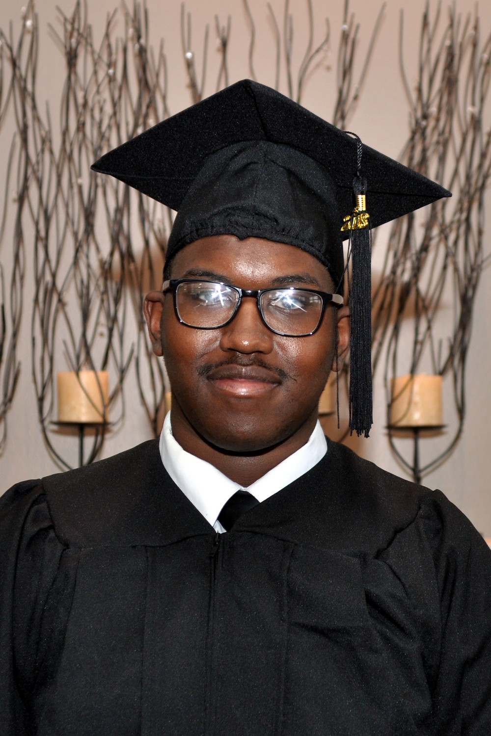 Kendrick Francis in his graduation cap and gown