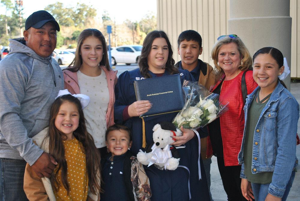 Kayla Lopez Rosales with her husband, kids, and HiSET instructor Janet