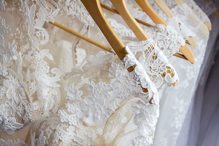 Wedding dresses hanging on a hanger. Fas
