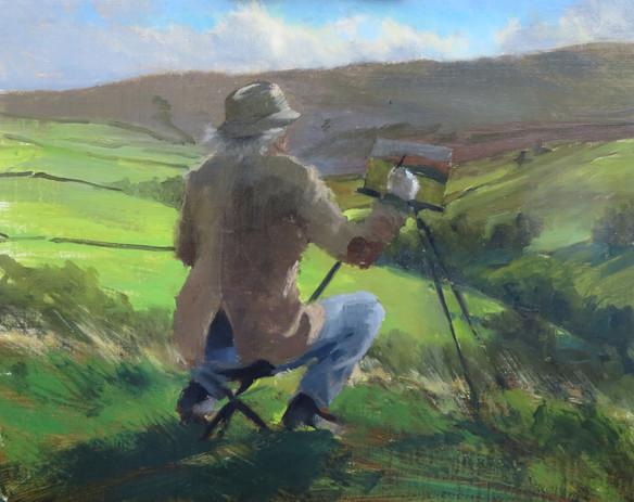 Earl painting on a windy hillside in Yor