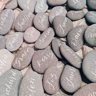 White inked pebble place names