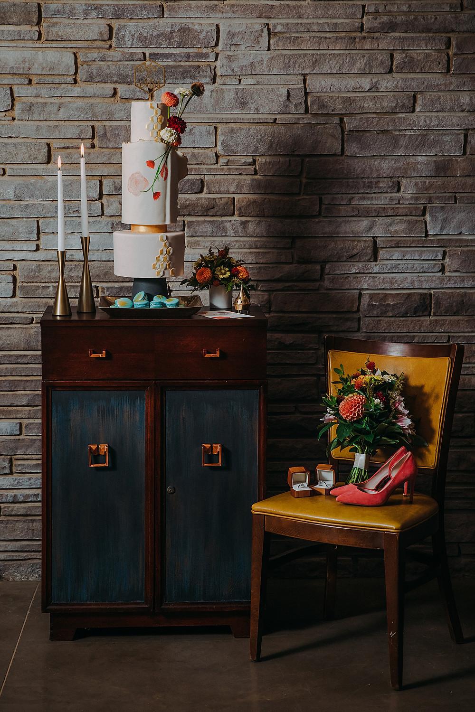 mid century modern wedding decor with geometric cake in a Mid-century modern Milwaukee Wedding