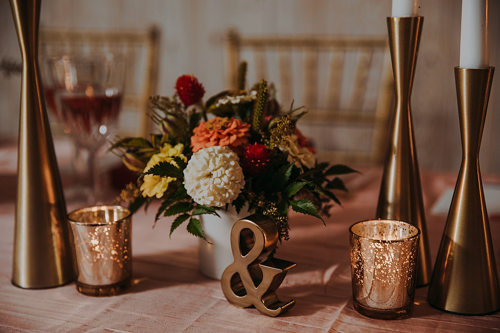 gold votives and decor for mid century modern wedding in Milwaukee, Wisconsin